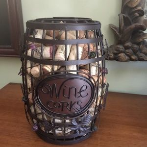 Wrought iron wine corks and holder.